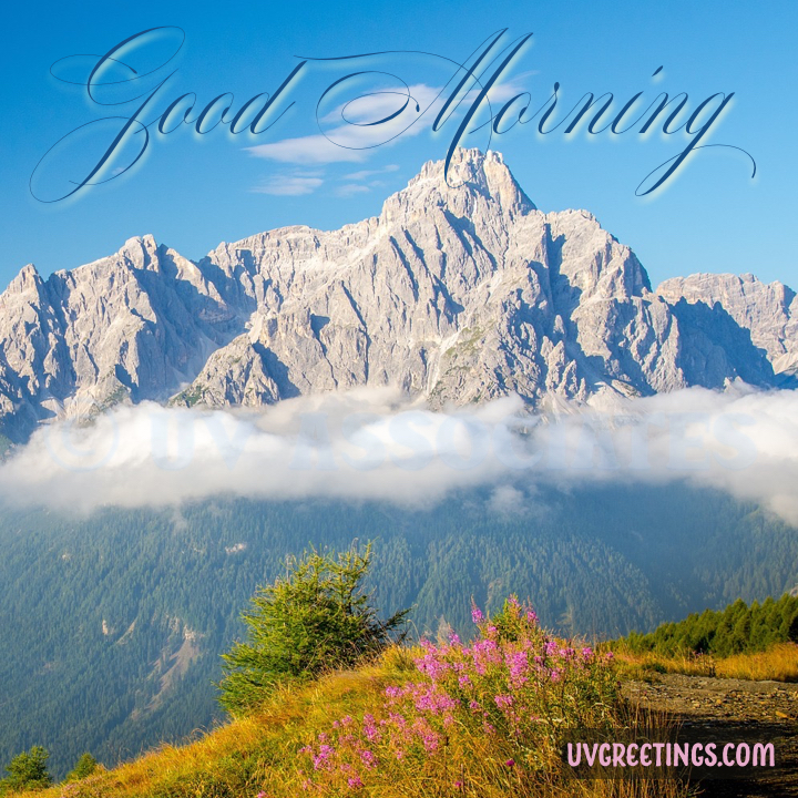 Clouds and Mountains with blue skies and beautiful good morning lettering